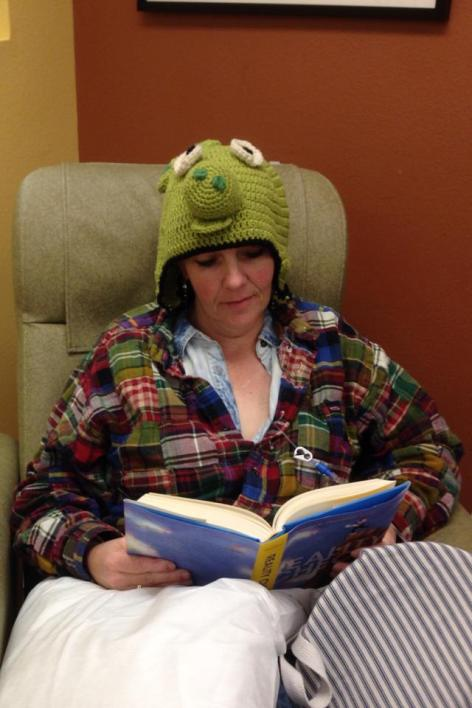 Nothing like a cozy pig hat, knit by Dale Roy, to keep you warm during a chemo treatment