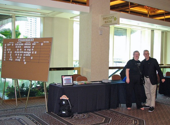 A forum welcome table at a TAM.  Natalie as she has for years welcoming everyone.