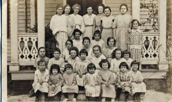 "The children of the ""Home for Friendless Children"".  No clue what was the real birthday of the little girl on sitting on the top step on the far left."