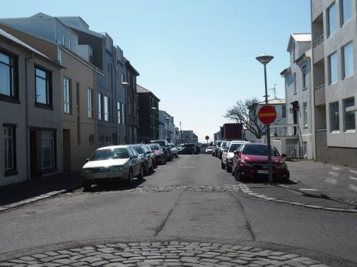 Typical Reykjavik intersection -- no street signs and only one usable lane.