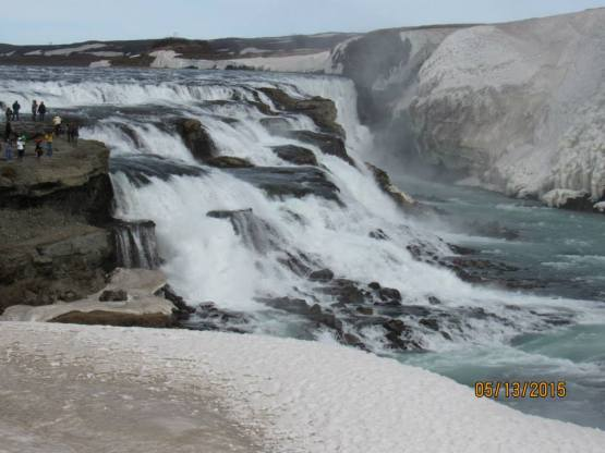 Gullfoss with ice at the fringes. Note the people in upper left, for scale. In summer it has TWELVE TIMES the flow at this time.
