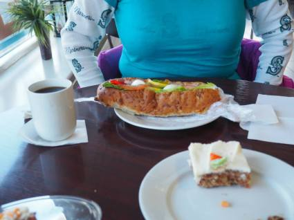 Icelandic meal: Kaffi, carrot cake, and a sandwich with a cup of shrimp, a hard-boiled egg, and ONE lettuce leaf
