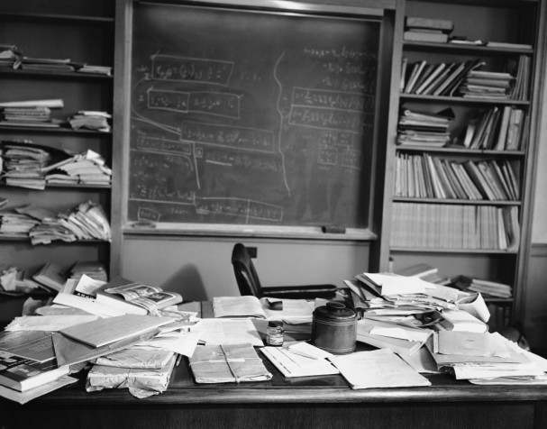"If you look up the word ""Genius"" in the dictionary, his photograph is there. This is the desk of someone that lives a tidy life of math and science in his mind, but likes his desk a mess."